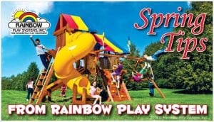 spring tips from rainbow play system - kids playing on wooden swing set